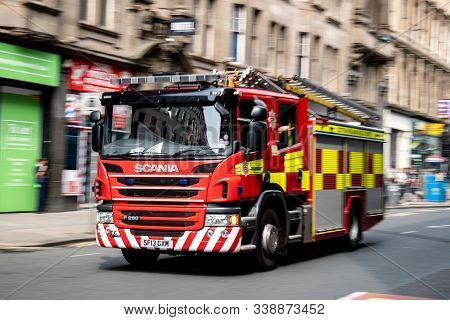 Glasgow, Scotland - July 31, 2019: A Red Scania P280 Fire Truck In The Streets Of Glasgow Driving Ve