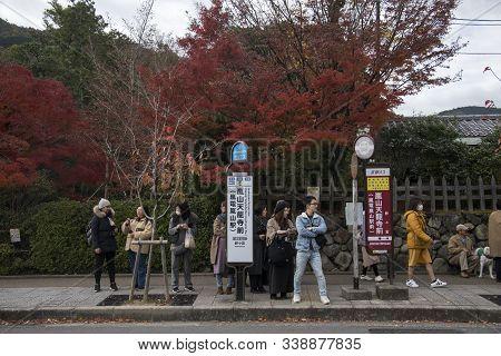 Kyoto, Japan-26 Nov, 2019:  People Waiting For City Bus In Arashiyama, Kyoto. The Kyoto City Buses A