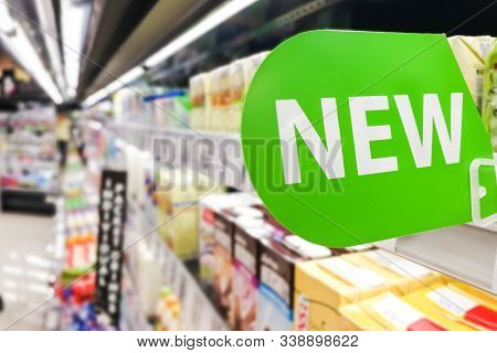 New Word Signage On Supermarket Shelf To Advertise New Product Arrival