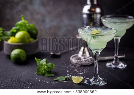 Margarita Cocktail With Lime In A Glass On Dark Background