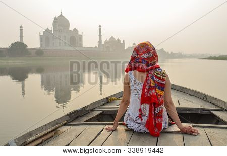 A Woman Watching Sunset Over Taj Mahal