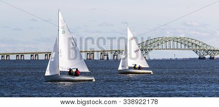 Babylon, New York, Usa - 7 December 2019: Small Sailboats In The Great South Bay Heading Back To Wes