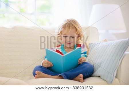Child Reading Book. Kids Read Books.