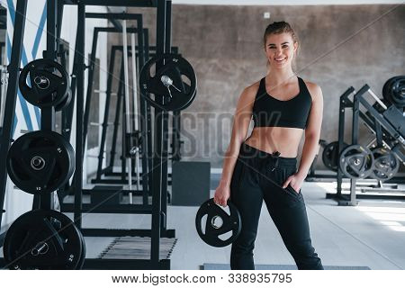 Many Of Equipment. Photo Of Gorgeous Blonde Woman In The Gym At Her Weekend Time.