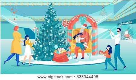 Santa Claus Sitting On Armchair And Holding Kid Little Girl On Knees Telling Him Verse. Happy Family