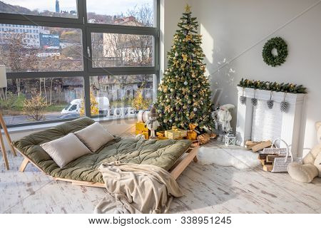Interior Of Christmas Decorated Living Room With Christmas Tree, Sofa And Big Window