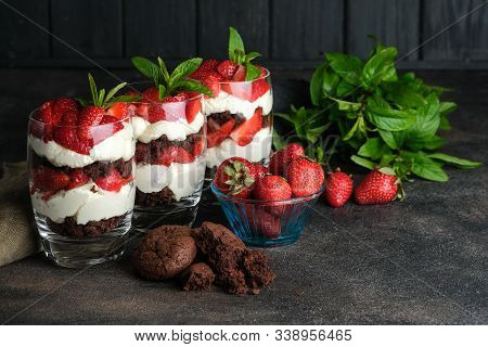 Strawberry Dessert. Trifles With Fresh Strawberries, Mint, Chocolate Biscuit And Delicate Cream. Lay