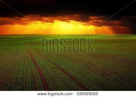 N Images Storm Dark Clouds And Light Over Field With Green Grass