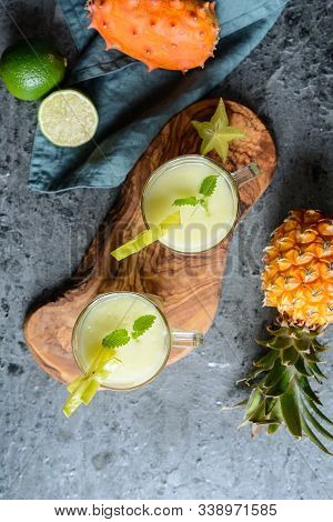 Kiwano And Pineapple Smoothie In A Glass Jar