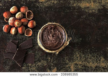 Chocolate Nut Paste, Hazelnuts And Dark Chocolate. Ingredients Concept Of Natural Chocolate Nut Past
