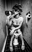 girl sits in a toilet with an alcohol bottle poster