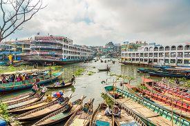 Dhaka,bangladesh - October 27,2019 - Boats On The Banks Of The Buriganga River In Dhaka. Dhaka Is Th