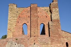 A Detail Of The Facade Of The Ancient Basilica  In The Province Of Siena - Italy