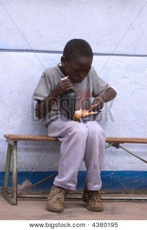 Boy Eating Lunch At School