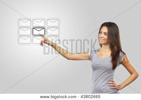 Woman pressing messaging icons