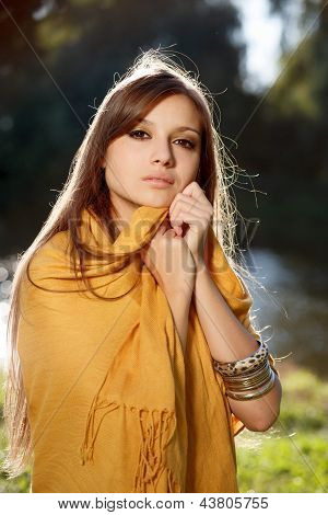 Young Beautiful Woman Wear Scarf In Her Shoulders