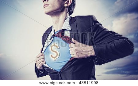 poster of Image of young businessman in superhero suit with dollar sign on chest