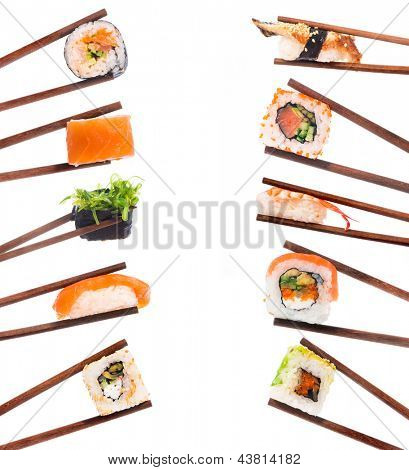Set of sushi with chopsticks shot on white