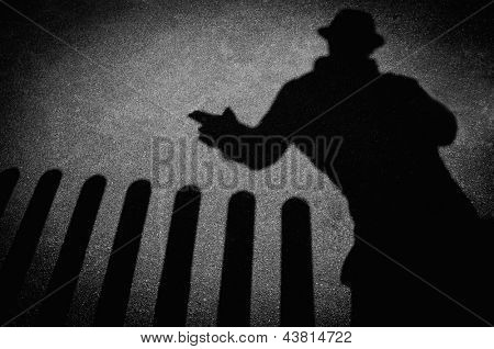Strangers shadow on pavement poster