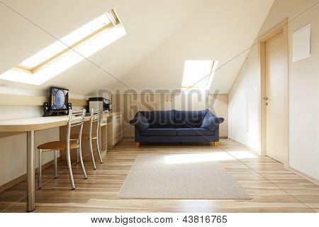 Modern room with mansard windows