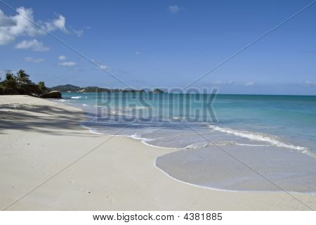 Beach In Antigua With The White Sands And Blue Water