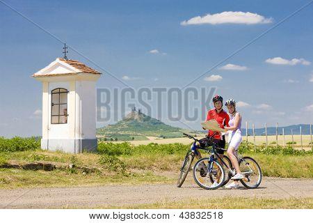 bikers holding a map, Hazmburk, Ceske stredohori, Czech Republic