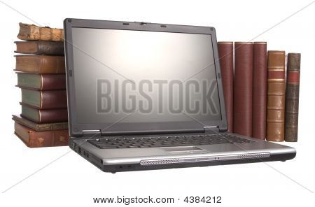 Old Leather Bound Books With A Laptop
