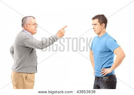 Angry father reprimanding his son with finger isolated on white background