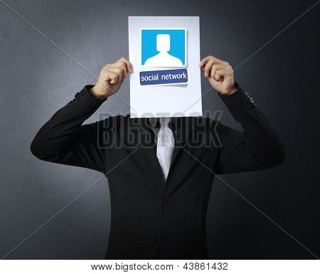 Business man handing social network business card over