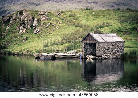 An old stone boathouse on a lake in Snowdonia, North Wales. Nostalgic effect with intentional vignetting.