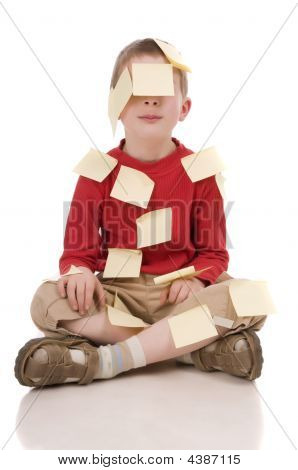 Young Boy With Papers Sticking On Him