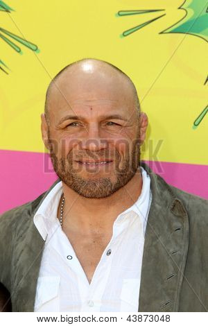 LOS ANGELES - MAR 23:  Randy Couture, Caden Couture arrives at Nickelodeon's 26th Annual Kids' Choice Awards at the USC Galen Center on March 23, 2013 in Los Angeles, CA