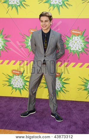 LOS ANGELES - MAR 23:  Jake T. Austin arrives at Nickelodeon's 26th Annual Kids' Choice Awards at the USC Galen Center on March 23, 2013 in Los Angeles, CA