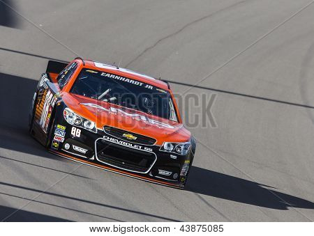 LAS VEGAS, NV - MAR 07, 2013:  Dale Earnhardt, Jr. (88) brings his AMP Chevrolet through the turns for the Kobalt Tools 400 at Las Vegas Motor Speedway in Las Vegas, NV on March 07, 2013.