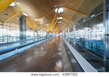 MADRID - MARCH 7: Hallway in Madrid Barajas Airport on March 7, 2012 in Madrid, Spain. Madrid Barajas Airport takes 11th busiest in world.