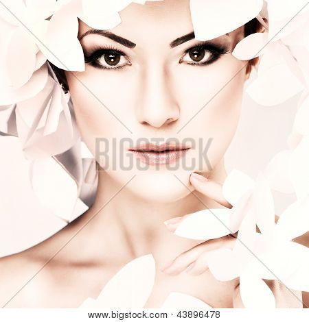 Wonderful girl in a hat from paper white butterflies. Beauty Face