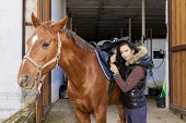 equestrian with her horse poster
