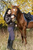 equestrian with her horse in autumnal nature poster
