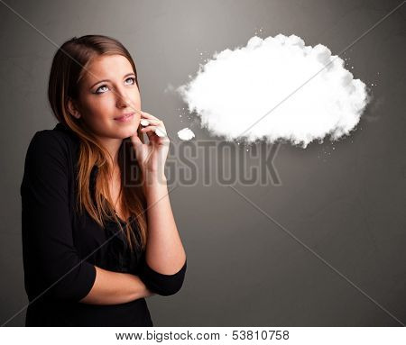 Pretty young lady thinking about cloud speech or thought bubble with copy space