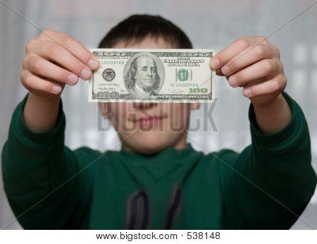 A Boy Shows 100 Dollars