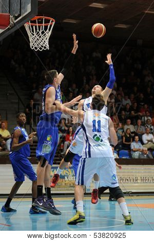 KAPOSVAR, HUNGARY � OCTOBER 26: Roland Hendlein (white 11) in action at a Hungarian Championship basketball game with Kaposvar (white) vs. Fehervar (blue) on October 26, 2013 in Kaposvar, Hungary.