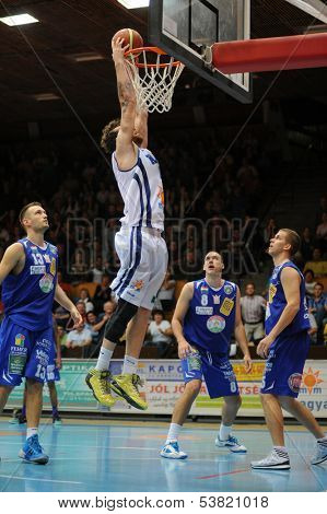 KAPOSVAR, HUNGARY � OCTOBER 26: Roland Hendlein (in white) in action at a Hungarian Championship basketball game with Kaposvar (white) vs. Fehervar (blue) on October 26, 2013 in Kaposvar, Hungary.