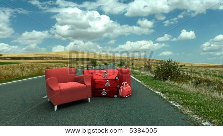 Sofa And Luggage In The Middle Of The Road