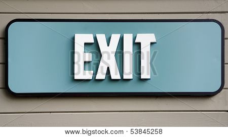 Exit sign on wooden panel wall