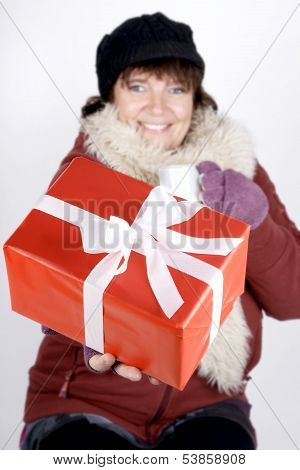 Woman With Hot Beverage And Christmas Present