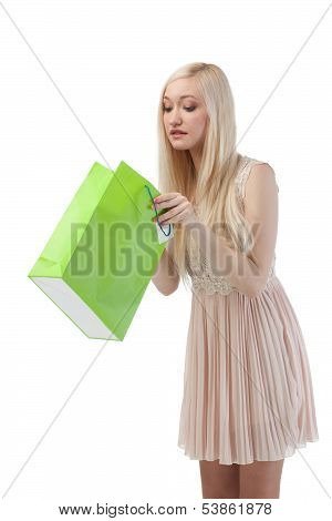 Woman Looking To Shopping Bag