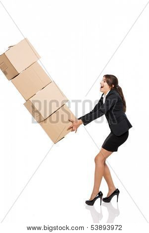 Business woman stumbling with a pile of card boxes on her hands, isolated on white