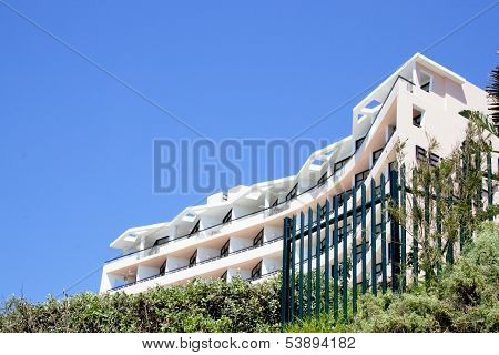 Abstract View Of Coastal Residential Building On Blue Sky