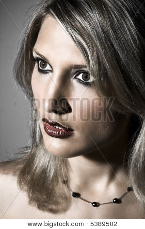 Closeup Portrait Of A Beautiful Blond Woman