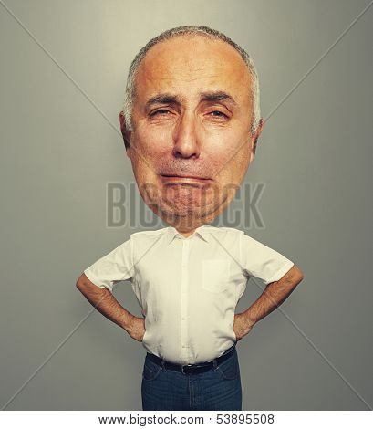 funny picture of whining senior man over grey background
